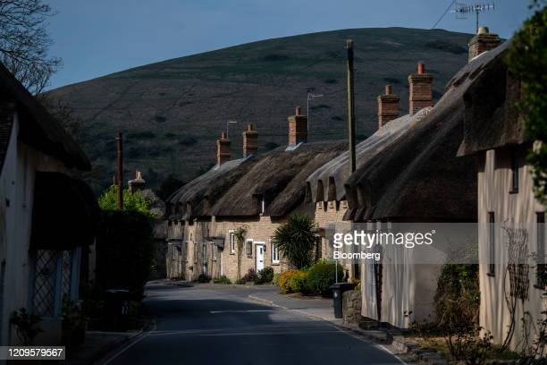 Traditional thatched cottages line an empty road during the national lockdown on Easter weekend in the village of West Lulworth, U.K., on Friday,...