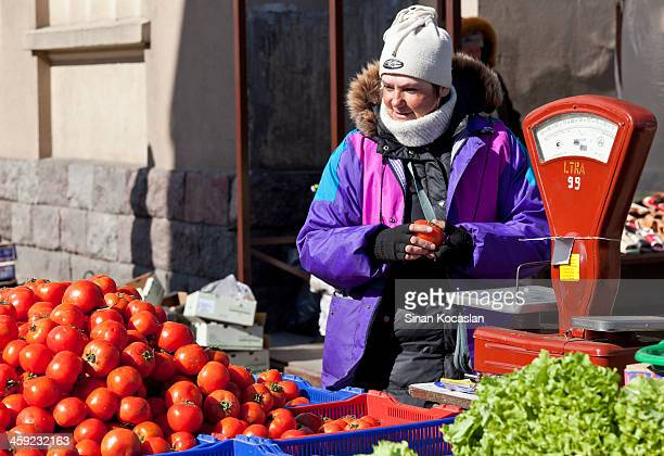 Traditional tomato seller at market place.