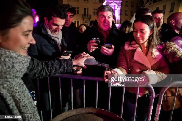 Traditional torchlight march followed by the breakthrough of the first barrel of Beaujolais Nouveau wine in Lyon France on November 21 2019 A public...