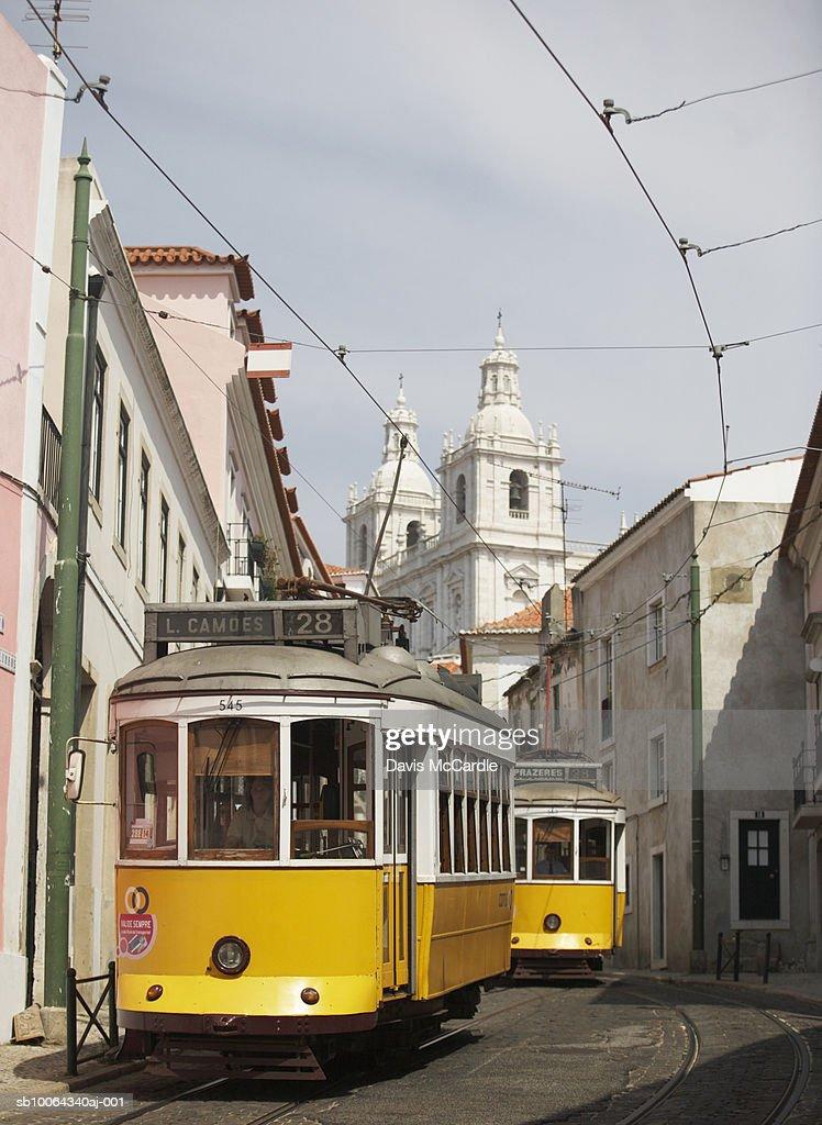 Traditional tram in Lisbon's Alfama district : ストックフォト
