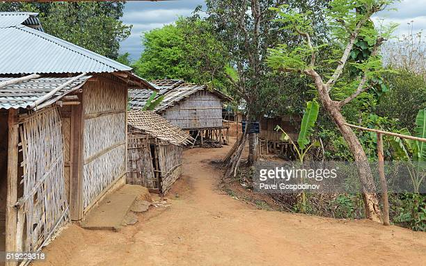 traditional tripura tribe bamboo houses, tarasha para (village) on sangu river, bandarban district, chittagong hill tracts, bangladesh - bangladesh village stock photos and pictures