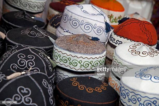 Traditional tubeteikas male Kyrgyz caps for sale at market in Osh Kyrgyzstan
