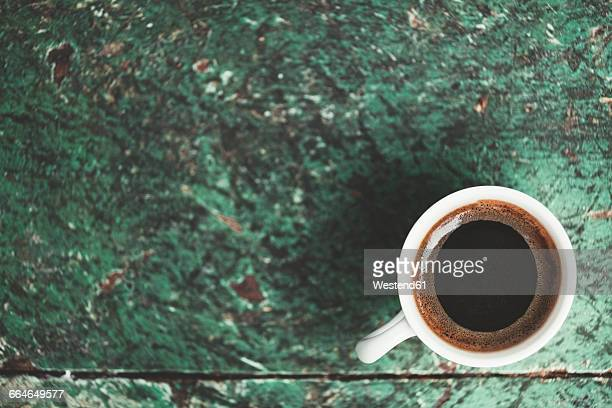 Traditional Turkish coffee in white cup