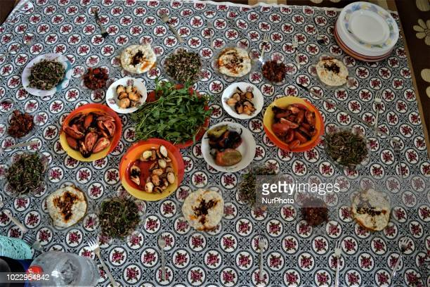 Traditional Turkish food sits on a table on the last day of Eid alAdha in southern Hatay province of Turkey on August 24 2018 Hatay is bordered by...