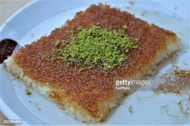 Traditional Turkish Hatay Kunefe dessert is pictured on the last day of Eid alAdha in southern Hatay province of Turkey on August 24 2018 Hatay is...