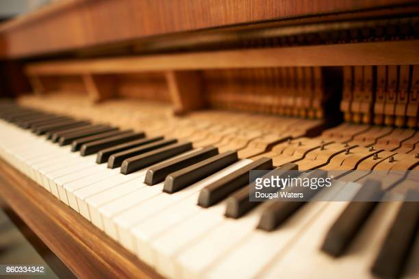 Traditional upright piano and keys close up.