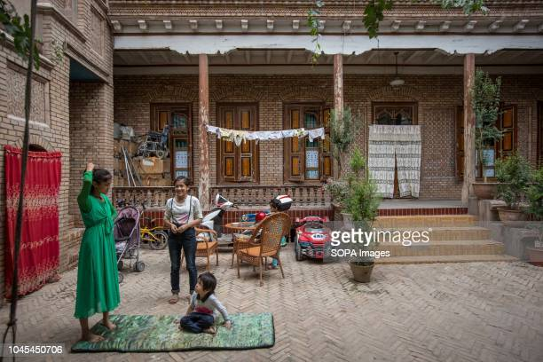 A traditional Uyghur family seen spending the afternoon together in the Kashgar old Town northwestern Xinjiang Uyghur Autonomous Region in China...