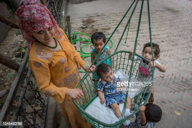 Traditional Uyghur family seen spending the afternoon together in the Kashgar old Town, northwestern Xinjiang Uyghur Autonomous Region in China....