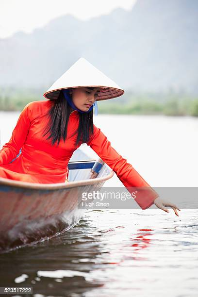 Traditional Vietnamese woman travelling on boat.