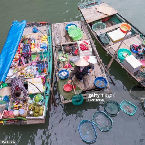 Traditional Vietnamese Women Vendors in Boats in Halong Bay Vietnam.