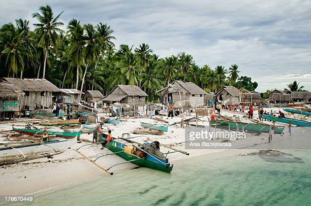Traditional village on one of the tropical island of the archipelago nearby Tawi Tawi in the southern edge of the Philippines.