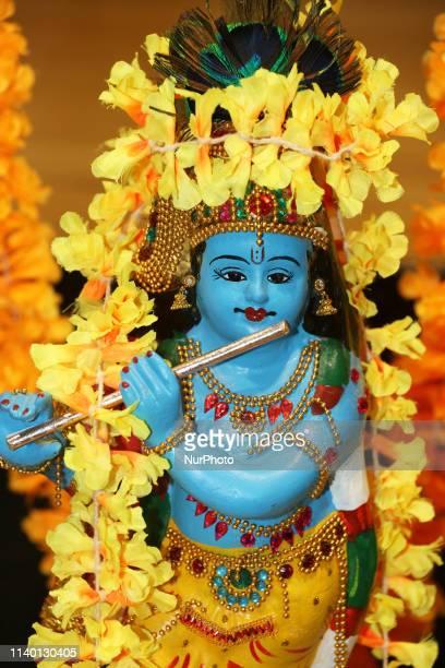 Traditional Vishu kani setting with a small idol of Lord Krishna seen during the Vishu Festival in Brampton, Ontario, Canada. Vishu is a major annual...