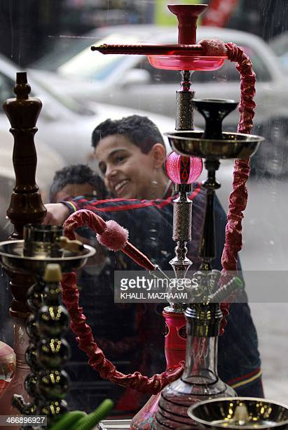 Traditional water pipes are displayed in a shop in the Jordanian capital Amman on January 28 2014 A ban on water pipes in restaurants and cafes has...