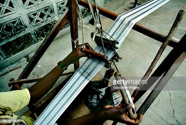 """Traditional weaver making """"kente"""" cloth, a local textile worn by royalty - in the village of Bonwire in the Ashanti Region of Ghana, West Africa."""