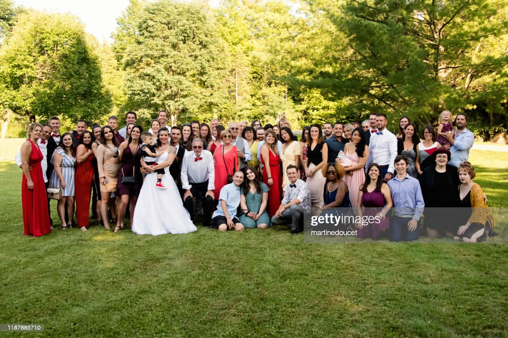 Traditional wedding portrait with family and friends : Stock Photo