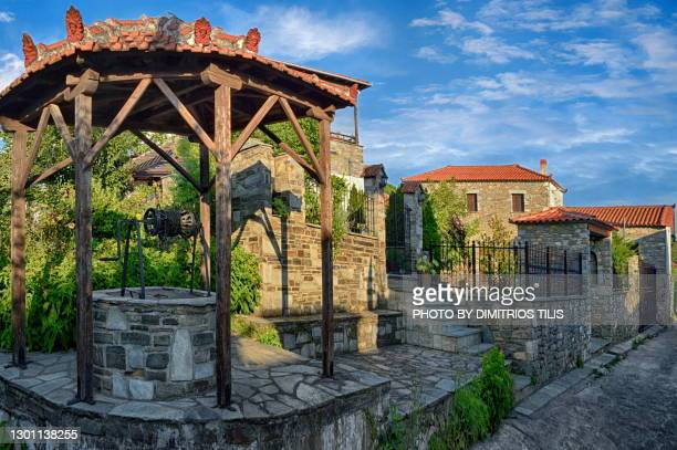 traditional  well at argalasti - dimitrios tilis stock pictures, royalty-free photos & images