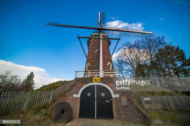 Traditional well preserved old Dutch Windmill in a village in the district of North Brabant in The Neherlands on 26 February 2018