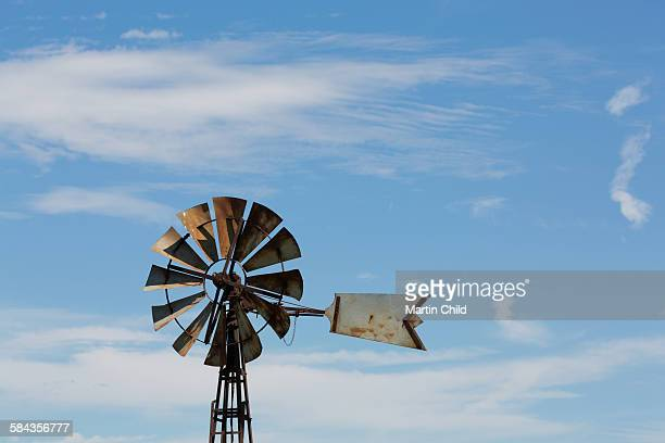 traditional wind pump - old windmill stock photos and pictures