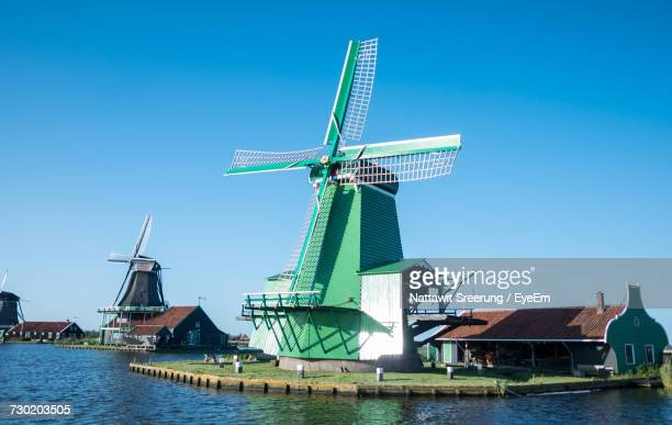 traditional windmill against clear blue sky - traditional windmill stock photos and pictures