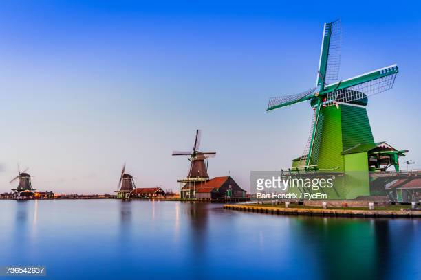 Traditional Windmill Against Clear Blue Sky