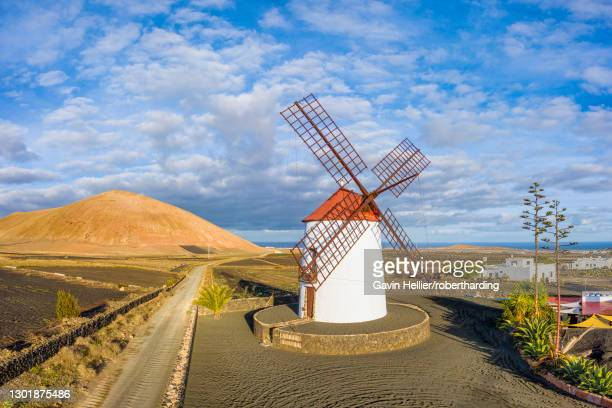 traditional windmill and volcanic landscape, tiagua, lanzarote, canary islands, spain, atlantic, europe - gavin hellier stock pictures, royalty-free photos & images