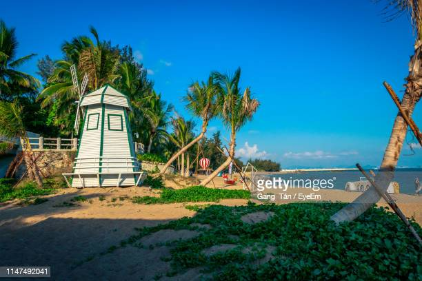 traditional windmill at coastline - sanya stock pictures, royalty-free photos & images