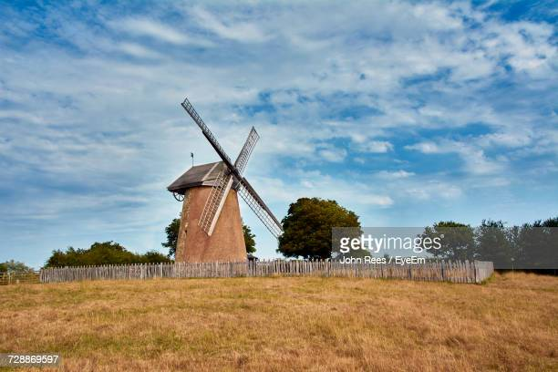 traditional windmill on field against sky - traditional windmill stock photos and pictures