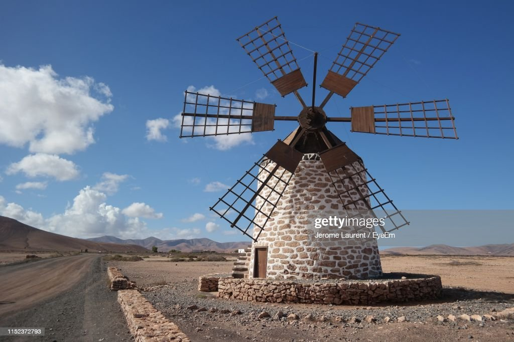 Traditional Windmill On Landscape Against Sky : Foto de stock