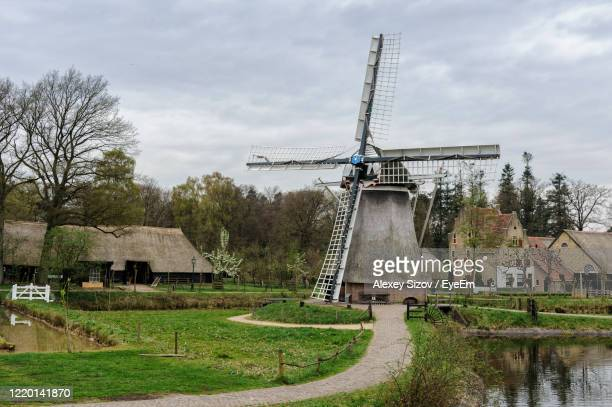 traditional windmill on landscape against sky - gelderland stock pictures, royalty-free photos & images