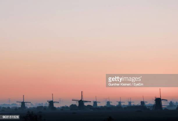traditional windmills against clear sky during sunset - traditional windmill stock photos and pictures