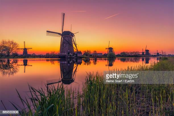 traditional windmills against sky during sunset - amsterdam stock pictures, royalty-free photos & images