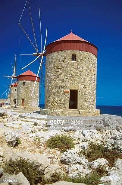 Traditional Windmills at Mandraki Harbor, Rhodes, Greece