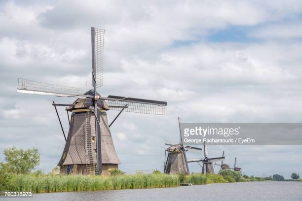 traditional windmills on field against sky - traditional windmill stock photos and pictures