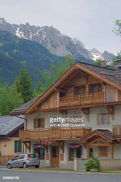 Traditional wooden Alpine chalet summer meadow snowy mountains