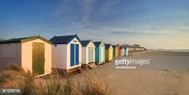 traditional wooden beach huts on the suffolk heritage coast of southwold. - coastline stock photos and pictures