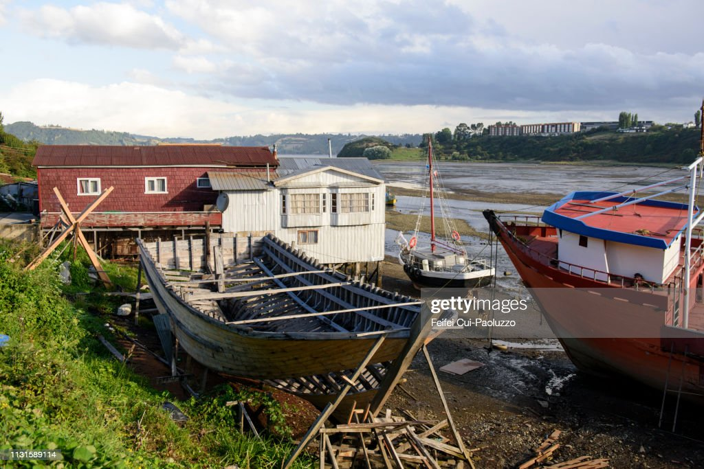 Traditional wooden boat repairing at Castro, Chiloe island, Chile : Stock Photo