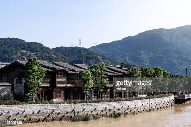 traditional wooden house on the waterfront - fuzhou stock pictures, royalty-free photos & images