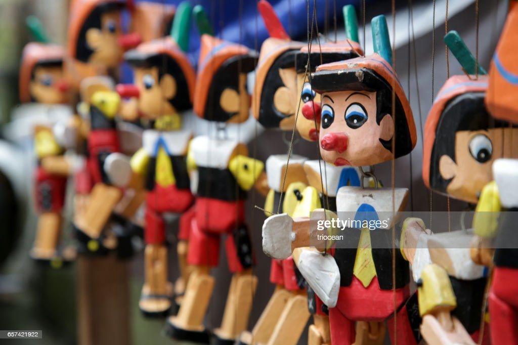 Traditional wooden Pinocchio toy on the market : Stock Photo