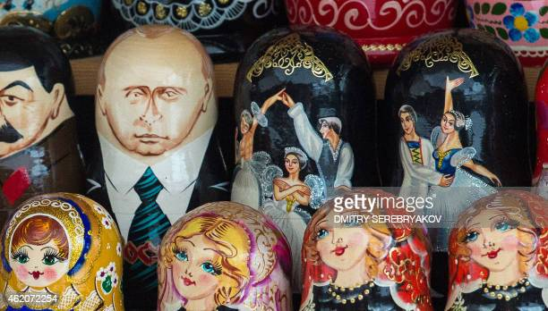 A traditional wooden Russian nesting doll a Matryoshka doll depicting Russia's President Vladimir Putin is displayed at a flea market in Moscow on...