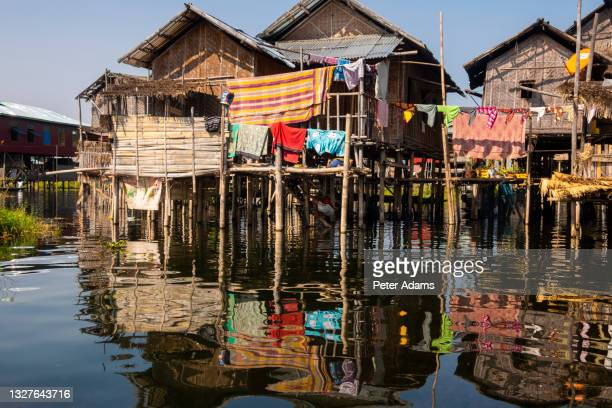 traditional wooden stilt houses at the inle lake, shan state, myanmar - peter adams stock pictures, royalty-free photos & images