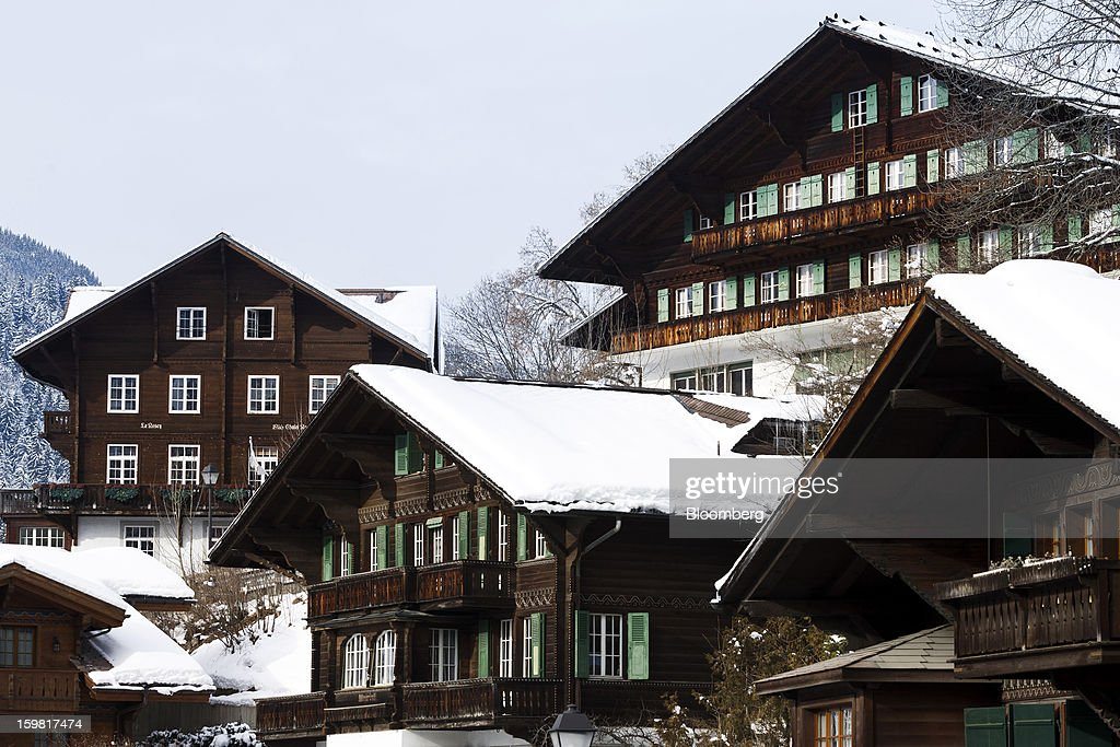 Traditional wooden Swiss chalets stand with snow-covered roofs in Gstaad, Switzerland, on Saturday, Jan. 19, 2013. Options traders are pushing the cost of bearish wagers on Swiss shares to the lowest level in almost seven years amid optimism a decline in the franc versus the euro will benefit the nation's exporters. Photographer: Valentin Flauraud/Bloomberg via Getty Images