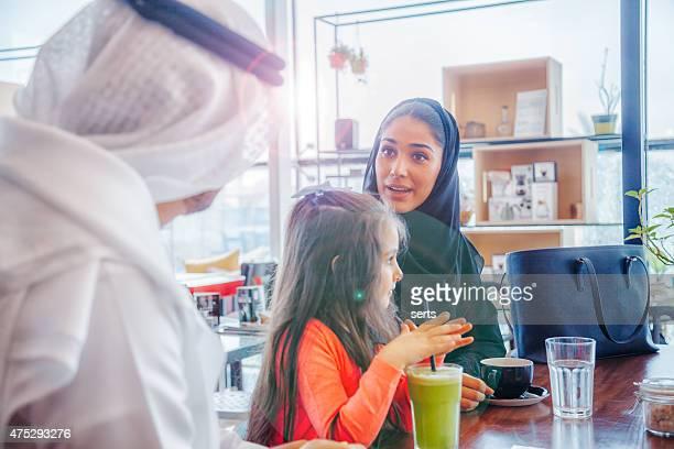 Traditional Young Arab family enjoying at cafe