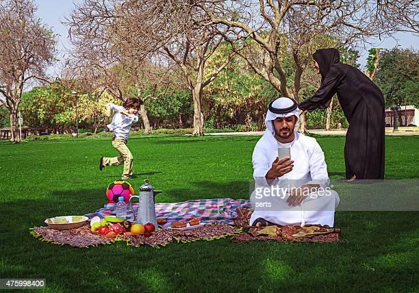 Traditional Young Arabic family having fun outdoors at picnic