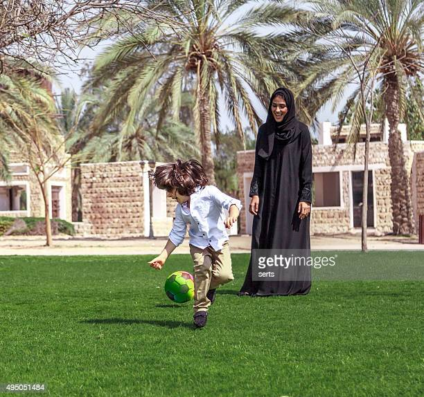 Traditional Young Arabic family having fun outdoors at sunny day