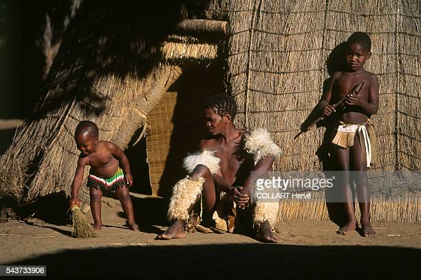 Traditional Zulu family of the royal village of Eshowe outside their hut