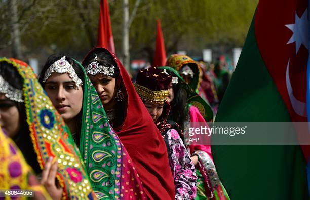 Traditionally clad Afghan women attend the official Nawroz festivities at the Presidential Palace in Kabul on March 27 2014 Nawroz the Persian New...