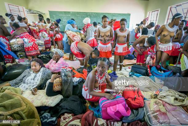 Traditionally clad Zulu maidens prepare to take part in the mini reed dance in the rural district of Emalangeni some 80kms north of Durban on August...