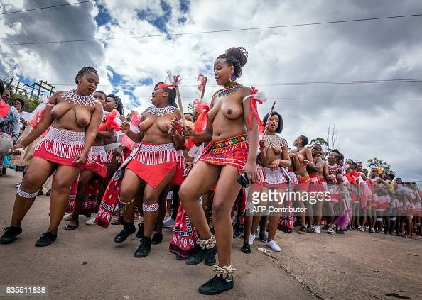 Traditionally clad Zulu maidens take part in the mini reed ...
