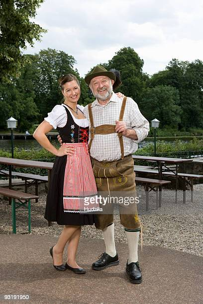 A traditionally clothed German man and woman in a beer garden