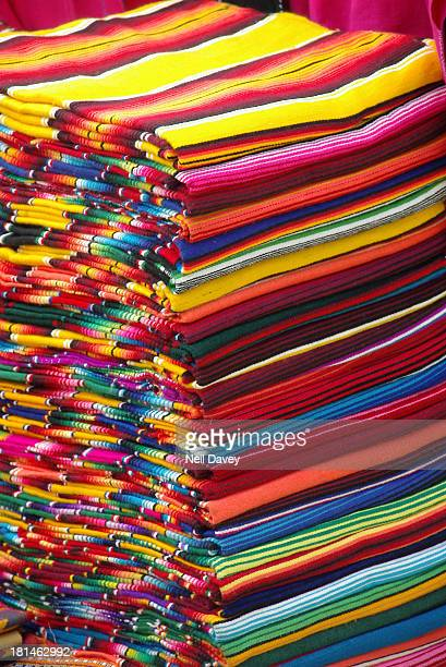 Traditionally coloured Mexican blankets on display in a market in San Cristobal de las Casas, Chiapas, Mexico.
